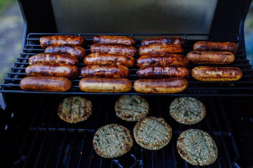 Brats and burgers on grill